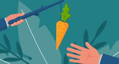 hand reaching for carrot on stick
